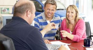 Couple Buying Car at Dealership